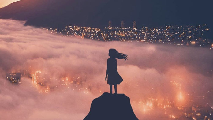girl on top of a mountain